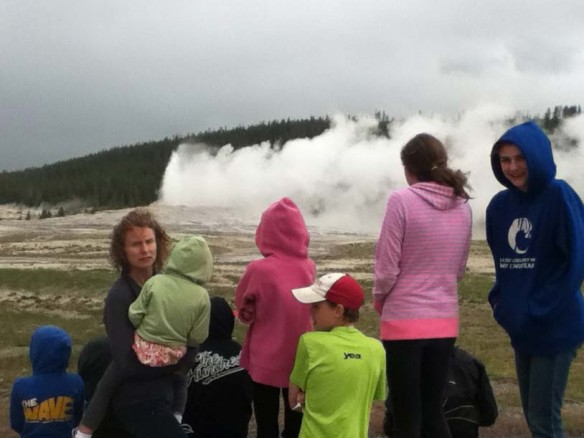 The family in front of Old Faithful