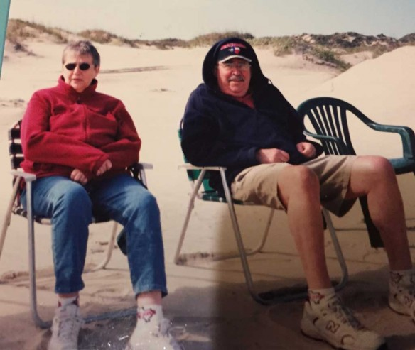 Mom and Dad in sweatshirts on South Padre Island