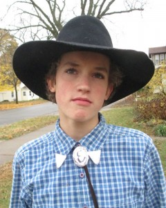 Edward in a cowboy hat looking serious