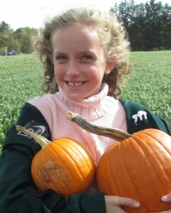 Ruthie holding pumpkins