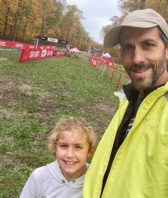 Bethany and Ed in a selfie at a bike race course